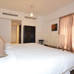Отель Vacation Holiday Homes - Jumeirah Beach Residences комната для гостей фото 5