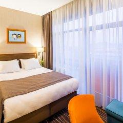 Гостиница Taurus City Львов комната для гостей фото 9