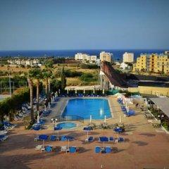 Отель Kapetanios Bay Hotel Кипр, Протарас - отзывы, цены и фото номеров - забронировать отель Kapetanios Bay Hotel онлайн бассейн фото 2