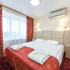 Амакс Премьер Отель комната для гостей