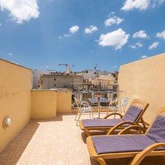Отель Spinola Bay Penthouse Мальта, Сан Джулианс - отзывы, цены и фото номеров - забронировать отель Spinola Bay Penthouse онлайн балкон фото 3