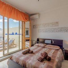 Отель Spinola Bay Penthouse Мальта, Сан Джулианс - отзывы, цены и фото номеров - забронировать отель Spinola Bay Penthouse онлайн комната для гостей фото 2