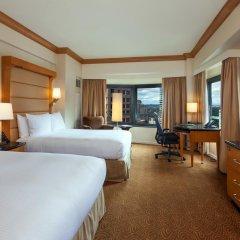 Отель New York Hilton Midtown 4* Семейный смежный номер с 2 отдельными кроватями фото 3