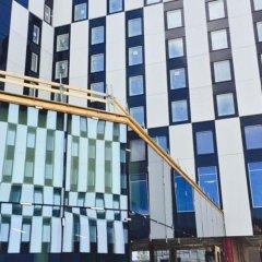Отель Clarion Hotel Helsinki Airport Финляндия, Вантаа - 11 отзывов об отеле, цены и фото номеров - забронировать отель Clarion Hotel Helsinki Airport онлайн вид на фасад фото 2
