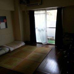 Отель Guest House Orange Fukuoka Хаката комната для гостей