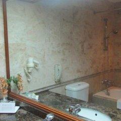 Отель Orchard Grand Court ванная