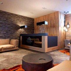 Гостиница Arkhyz Royal Resort & Spa в Архызе отзывы, цены и фото номеров - забронировать гостиницу Arkhyz Royal Resort & Spa онлайн Архыз интерьер отеля