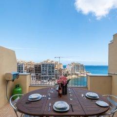 Отель Spinola Bay Penthouse Мальта, Сан Джулианс - отзывы, цены и фото номеров - забронировать отель Spinola Bay Penthouse онлайн балкон фото 2