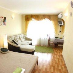 Апартаменты «Альфа на Маркса» Омск комната для гостей фото 5