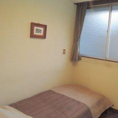Отель Travel Inn Yoshitomi Минамиогуни комната для гостей