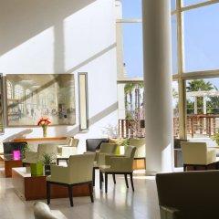 Golden Tulip Golden Bay Beach Hotel Ларнака интерьер отеля