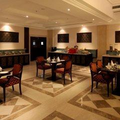 Отель Country Inn & Suites By Carlson, Satbari, New Delhi Индия, Нью-Дели - отзывы, цены и фото номеров - забронировать отель Country Inn & Suites By Carlson, Satbari, New Delhi онлайн питание