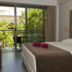 Отель Oktober Down Town Rooms Греция, Родос - отзывы, цены и фото номеров - забронировать отель Oktober Down Town Rooms онлайн комната для гостей фото 4