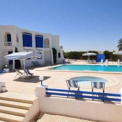 Отель Dar Sofiane Тунис, Мидун - отзывы, цены и фото номеров - забронировать отель Dar Sofiane онлайн бассейн фото 3