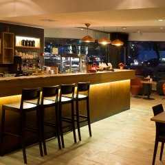 GO Hotel Snelli гостиничный бар фото 2