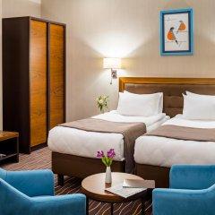 Гостиница Taurus City Львов комната для гостей фото 3