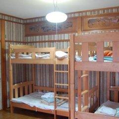 Отель Guest House Aloha Spirit Hakata Station Фукуока комната для гостей