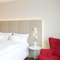 Отель NH Collection Frankfurt City 4* Улучшенный номер с различными типами кроватей фото 7
