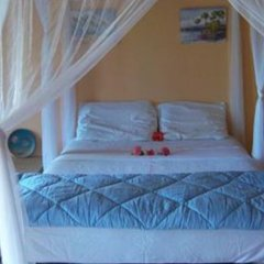 Отель By The Sea Vacation Home And Villa комната для гостей фото 4