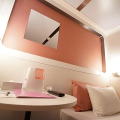 Отель First Cabin Akihabara Япония, Токио - отзывы, цены и фото номеров - забронировать отель First Cabin Akihabara онлайн удобства в номере фото 2