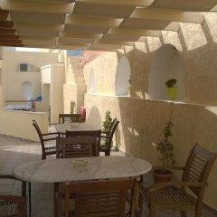 Отель Anemomilos Suites Греция, Остров Санторини - отзывы, цены и фото номеров - забронировать отель Anemomilos Suites онлайн питание фото 2