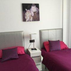 Отель OasisBeach Penthousse la Zénia комната для гостей фото 3
