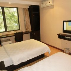 Forest Hotel - Guangzhou сейф в номере