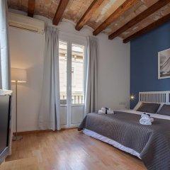 Апартаменты Habitat Apartments Beach Studio Барселона комната для гостей фото 4