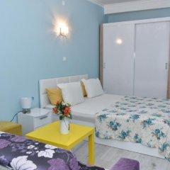 Апартаменты White Rose Apartments Стандартный семейный номер разные типы кроватей фото 16