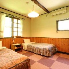 Отель Flower Garden Япония, Минамиогуни - отзывы, цены и фото номеров - забронировать отель Flower Garden онлайн комната для гостей фото 3