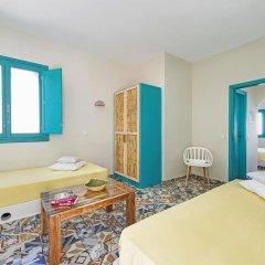 Апартаменты Nissia Apartments Семейный люкс с двуспальной кроватью