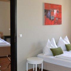 Отель Goldfisch Vienna City Apartments Австрия, Вена - отзывы, цены и фото номеров - забронировать отель Goldfisch Vienna City Apartments онлайн комната для гостей фото 5