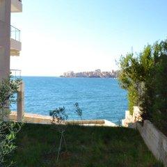 Отель Azzurra Apartments Албания, Саранда - отзывы, цены и фото номеров - забронировать отель Azzurra Apartments онлайн пляж фото 2