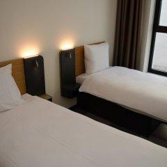 Отель easyHotel Brussels City Centre 3* Стандартный номер с 2 отдельными кроватями фото 10