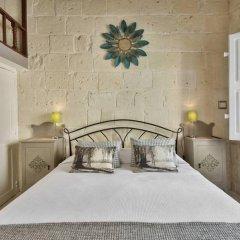 Отель Magnificent House of Character Мальта, Гранд-Харбор - отзывы, цены и фото номеров - забронировать отель Magnificent House of Character онлайн комната для гостей фото 2