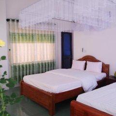 Отель Sac Xanh Homestay Стандартный семейный номер с двуспальной кроватью