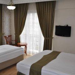 Basileus Hotel 3* Стандартный семейный номер разные типы кроватей фото 8