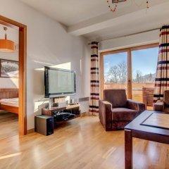 Отель Apartamenty Snowbird Zakopane Косцелиско комната для гостей фото 4