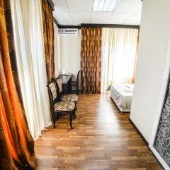 Гостиница Виноградная лоза Улучшенный семейный номер с двуспальной кроватью фото 3
