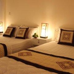 Legend Saigon Hotel Семейный номер Делюкс с двуспальной кроватью фото 4