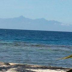Отель Serenity Beach Cottages Гондурас, Остров Утила - отзывы, цены и фото номеров - забронировать отель Serenity Beach Cottages онлайн пляж фото 2