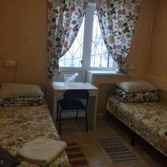 Хостел В Тапочках Стандартный семейный номер с двуспальной кроватью фото 2