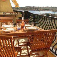 Отель SeaView Apartment in Saint Thomas Bay Мальта, Марсаскала - отзывы, цены и фото номеров - забронировать отель SeaView Apartment in Saint Thomas Bay онлайн питание