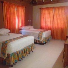 Отель Palm Bay Guest House & Restaurant Ямайка, Монтего-Бей - отзывы, цены и фото номеров - забронировать отель Palm Bay Guest House & Restaurant онлайн комната для гостей фото 2