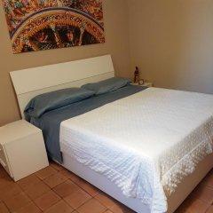 Отель L'Oasi di San Giovanni Сан-Джованни-ла-Пунта комната для гостей фото 4