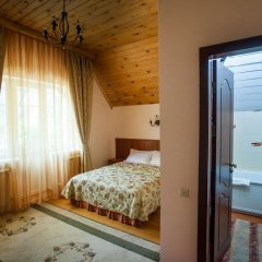 Гостиница Каприз Стандартный номер с двуспальной кроватью фото 4