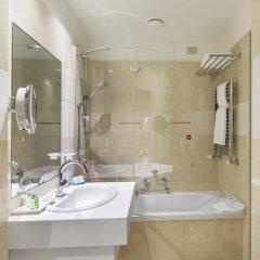 Отель NH Milano Touring 4* Улучшенный номер разные типы кроватей фото 41
