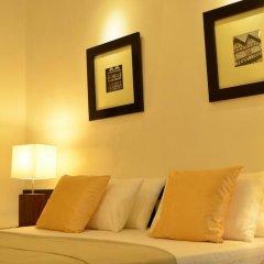 Отель 26 Loversleap Cottage сейф в номере