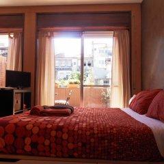 Апартаменты Studio Guimarães комната для гостей фото 2