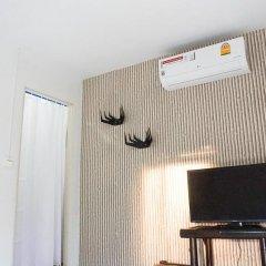 Отель Yanui Beach Hideaway сейф в номере
